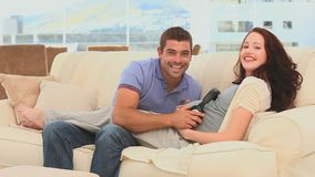 Couple letting his future baby listening to music Stock Photos