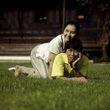 Couple lie on ground in park relaxing Royalty Free Stock Image