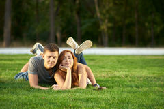 Couple lie on the lawn Stock Photography