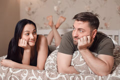 Couple lies in a bed and dreams. Royalty Free Stock Photo