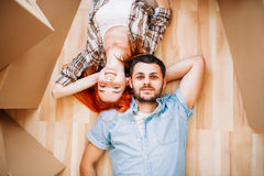 Couple lies on the floor, top view, new house royalty free stock photography