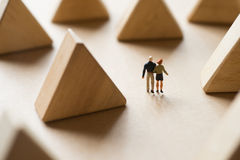 Couple life concept. Couple life concept, Happy man and woman walking along triangle wood block scene Stock Image
