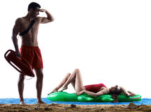 Couple lifeguards on the beach Stock Photography