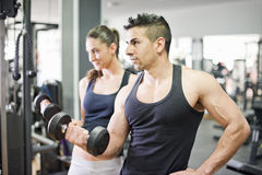 Couple lifting weights Stock Image