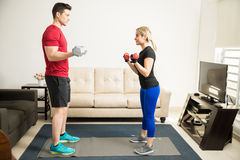 Couple lifting weights and working out Stock Photography