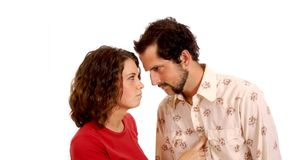 Couple lightly arguing. Man and woman with tension between them royalty free stock photography