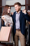 Couple likes go hopping. Smiley couple likes shopping in the mall Royalty Free Stock Photos