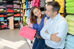 Couple in linen store. Linen Stock Photography