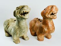Couple of Lion in Chinese terracotta. Used as a guardian of the house, showing the family flag. Isolated on a white background. Couple of Lion in Chinese stock photography