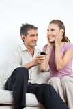 Couple Listening Music On Cell Phone Royalty Free Stock Photography