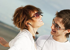 couple listening music to together Royaltyfri Foto