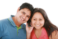 Couple are listening to a friend on a cell phone. Stock Photo