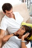 Couple listening to music Stock Image