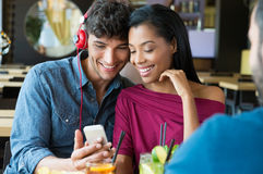 Couple listening to music at bar Stock Images