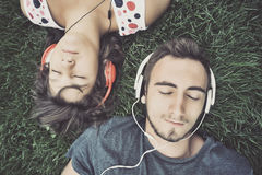 Couple listening to music. On headphones Royalty Free Stock Images