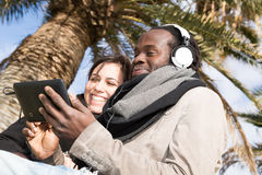 Couple listening to music Royalty Free Stock Images