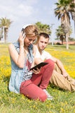 Couple listening to music. Lovers listening to music in the park Royalty Free Stock Image