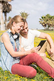 Couple listening to music Royalty Free Stock Photos