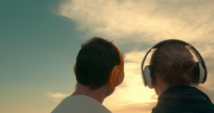Couple Listening to Music Outdoors stock video