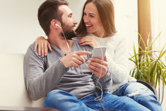 Couple listening to music Stock Photo