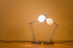 Couple of lit lamps Stock Photography