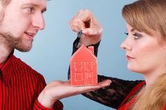 Couple with little house and silver coin. Stock Image