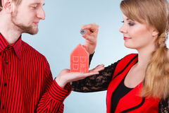 Couple with little house and silver coin. Royalty Free Stock Photography