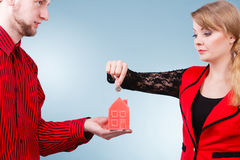 Couple with little house and silver coin. Stock Images