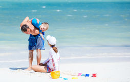 Couple with little son having fun on the beach Royalty Free Stock Images