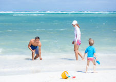 Couple with little son having fun on the beach Stock Image
