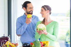 Couple living healthy eating fruits and vegetables. Man and women living vegetarian and healthy by eating fruits and vegetables Stock Image