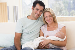 Couple in living room with baby Royalty Free Stock Images