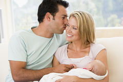 Couple in living room with baby Royalty Free Stock Photography