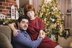 Couple in the living room decorated for Christmas and New Year stock photography