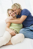 Couple in living room hugging and smiling Royalty Free Stock Photos
