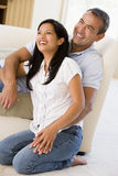 Couple in living room laughing Royalty Free Stock Images