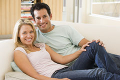 Couple in living room smiling Royalty Free Stock Photo