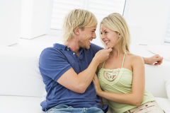 Couple in living room smiling Royalty Free Stock Images