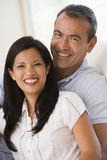 Couple in living room smiling.  stock photos