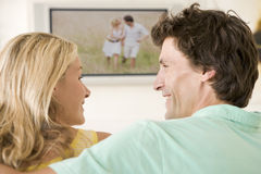 Couple in living room watching television Royalty Free Stock Photo