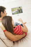 Couple in living room watching television Royalty Free Stock Photography