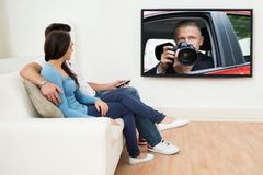 Couple in livingroom watching television Royalty Free Stock Photography