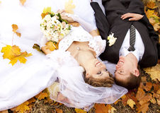 Couple liying down at the park Royalty Free Stock Photo