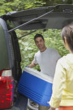 Couple Loading Car In Forest Royalty Free Stock Photo