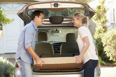 Couple Loading Large Package Into Back Of Car Stock Photos