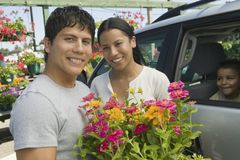Couple Loading Plants into Minivan at plant nursery portrait Royalty Free Stock Image