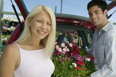 Couple Loading Plants Into Minivan portrait Stock Photo