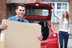 Couple Loading Purchase Into The Boot Car Royalty Free Stock Photo
