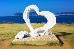 A couple located in the object of the heart at Cape Hado in Karatsu, Japan Royalty Free Stock Photo