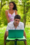 Couple loking in laptop Stock Images